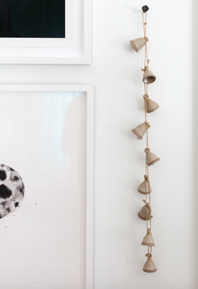 This Bell Garland includes 12 strung ceramic bells.