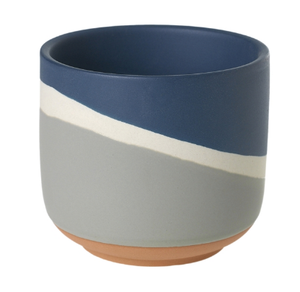 The Colorway Pots has a wave of three colors - Sand, Cream, and  deep blue.