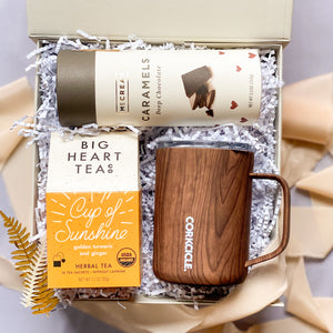 This Cozy Gift Box is a great way to send a little love to anyone! Choose between a peppery, naturally sweet chai or turmeric, ginger, tea, the amazing corkcicle insulated mugs, and mouthwatering, locally made McCreas Velvety cocoa coupled with luscious sweet cream caramel.