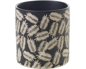 Inspired by modern foliage, the Folly Pot boasts a simple cylinder, elevated with a matte black glaze and stamped-leaf pattern.