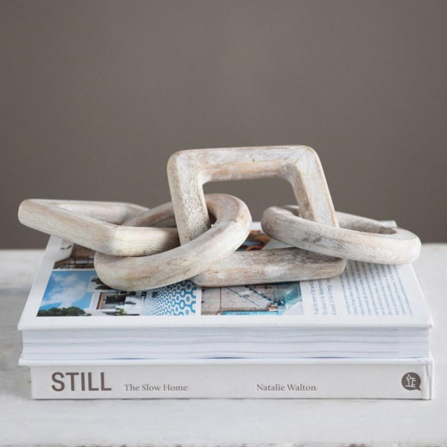 Whitewashed Mango Wood Chain Decor displayed on book  stack