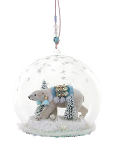 This globe ornament showcases an ornately dressed Polar Bear under the Northern Lights