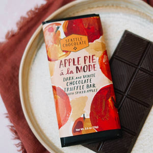 Apple Pie a la mode delights your taste buds with creamy white chocolate center with chunky apples, biscotti and spice, enrobed in rich dark chocolate