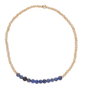 This Deep Blue Sodalite Gold Bliss Bead Bracelet adds a pop of color to any stack!