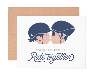 "Who do you ride side-by-side with when you hit the bike trails. Share your love with this greeting card. The letterpress design of the card includes the message, ""Lucky to be on this ride together."" The inside of the card is blank to give you plenty of room to write a caring note."