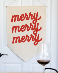 This merry merry banner adds the Christmas spirit to any wall with a pop of color.