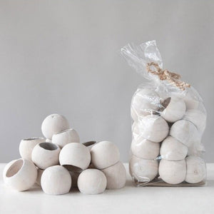 Bag of Natural Bells with a stack of whitewashed next to bag