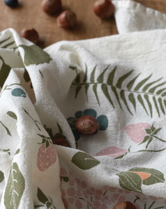 This playful towel pattern of  wild nuts and  berries is a subtle way to bring some color and fun into a home.
