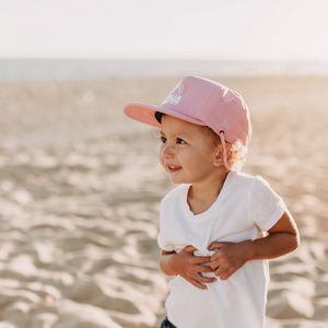 Aloha Rainbow Trucker Sun Hat on toddler on beach