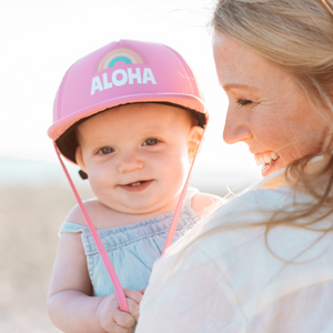 Aloha Rainbow Trucker Sun Hat on baby girl with blonde mom