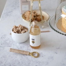 Load image into Gallery viewer, Brass and Bamboo Bottle Opener on granite table with dessert tiered tray