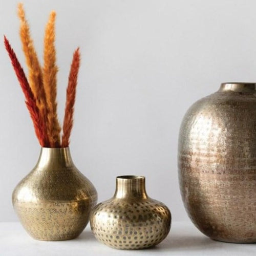Assorted Hammered Brass Vases with dried orange brush