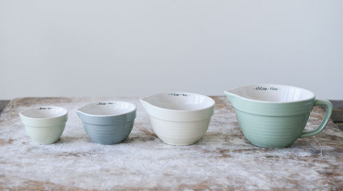 Set of 4 stoneware measuring cups in soft shades of blue & green that you will want to leave on the counters because they are so cute! Batter Bowl Shaped  Each set comes with 1-1/2, 1, 1/2, 1/4 Cups