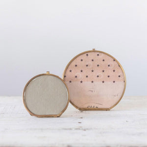 Round Brass and Glass Photo Frame shown with smaller round frame