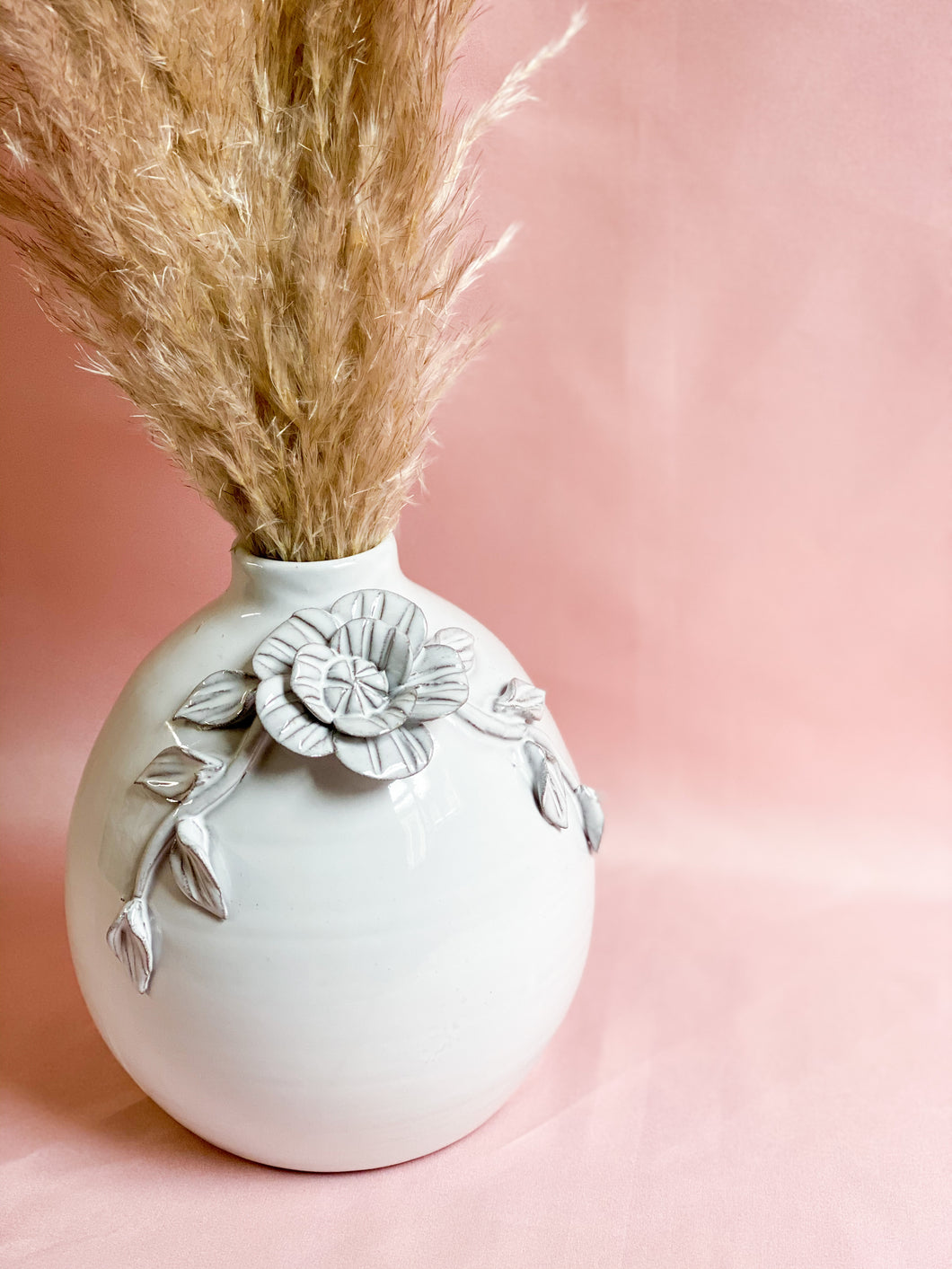 Perfect piece of ceramic With this adorable flower detail for any side table or shelf styling