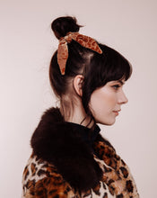 Load image into Gallery viewer, The Hendrix Gold Velvet Scrunchie Tie in woman with leopard coat