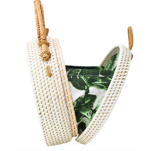 White Milly Rattan Bag open with palm leaf patterned fabric
