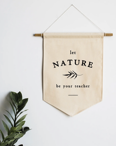 Let Nature Be Your Teacher Canvas Banner Canvas Banner on wall with plant