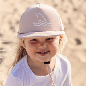 Blush Shark Fin Trucker Sun Hat on blonde toddler at the beach