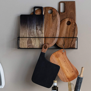 Various Suar Wood Cutting Boards hanging on wall