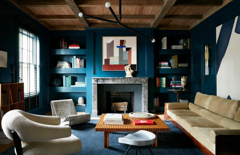 In the living room of a historic Watch Hill, Rhode Island, house, Studio Giancarlo Valle clad the walls in a rich blue. Photo by Stephen Kent Johnson.