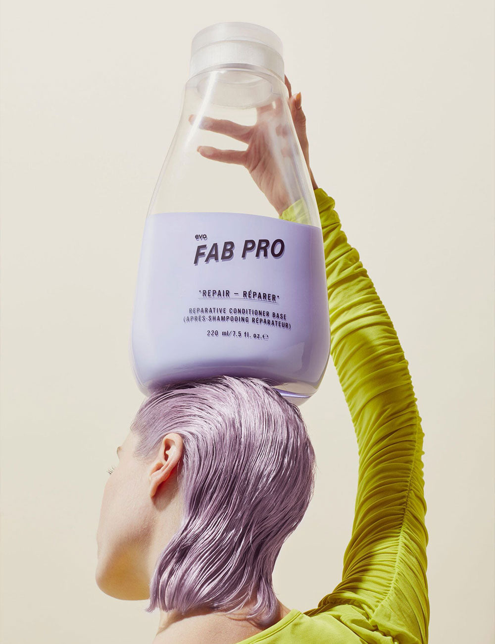 a woman with lovely purple hair holding a bottle on top of her head