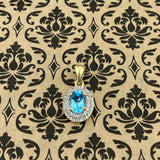 Gold Finish Blue Topaz and White Topaz pendant set in 925 Sterling Silver