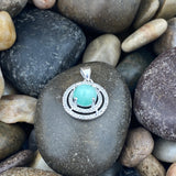 Emerald and White Topaz pendant set in 925 Sterling Silver