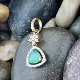 Gold Finish Emerald and White Topaz pendant set in 925 Sterling Silver