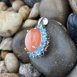 Peach Moonstone and Blue Topaz pendant set in 925 Sterling Silver