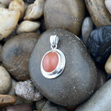 Peach Moonstone pendant set in 925 Sterling Silver