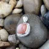 Peach Moonstone and White Topaz pendant set in 925 Sterling Silver