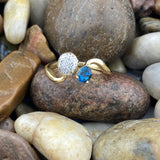 Gold Finish Blue Topaz and White Topaz ring set in 925 Sterling Silver