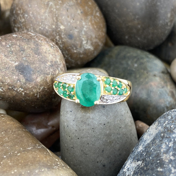 Gold Finish Emerald and White Topaz ring set in 925 Sterling Silver