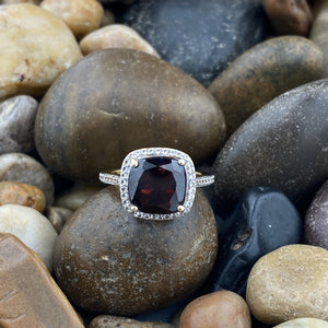 Gold Finish Garnet and White Topaz ring set in 925 Sterling Silver