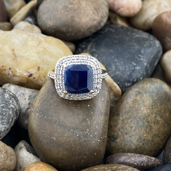 Gold Finish Sapphire and White Topaz ring set in 925 Sterling Silver