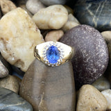 Gold Finish Tanzanite and White Topaz ring set in 925 Sterling Silver