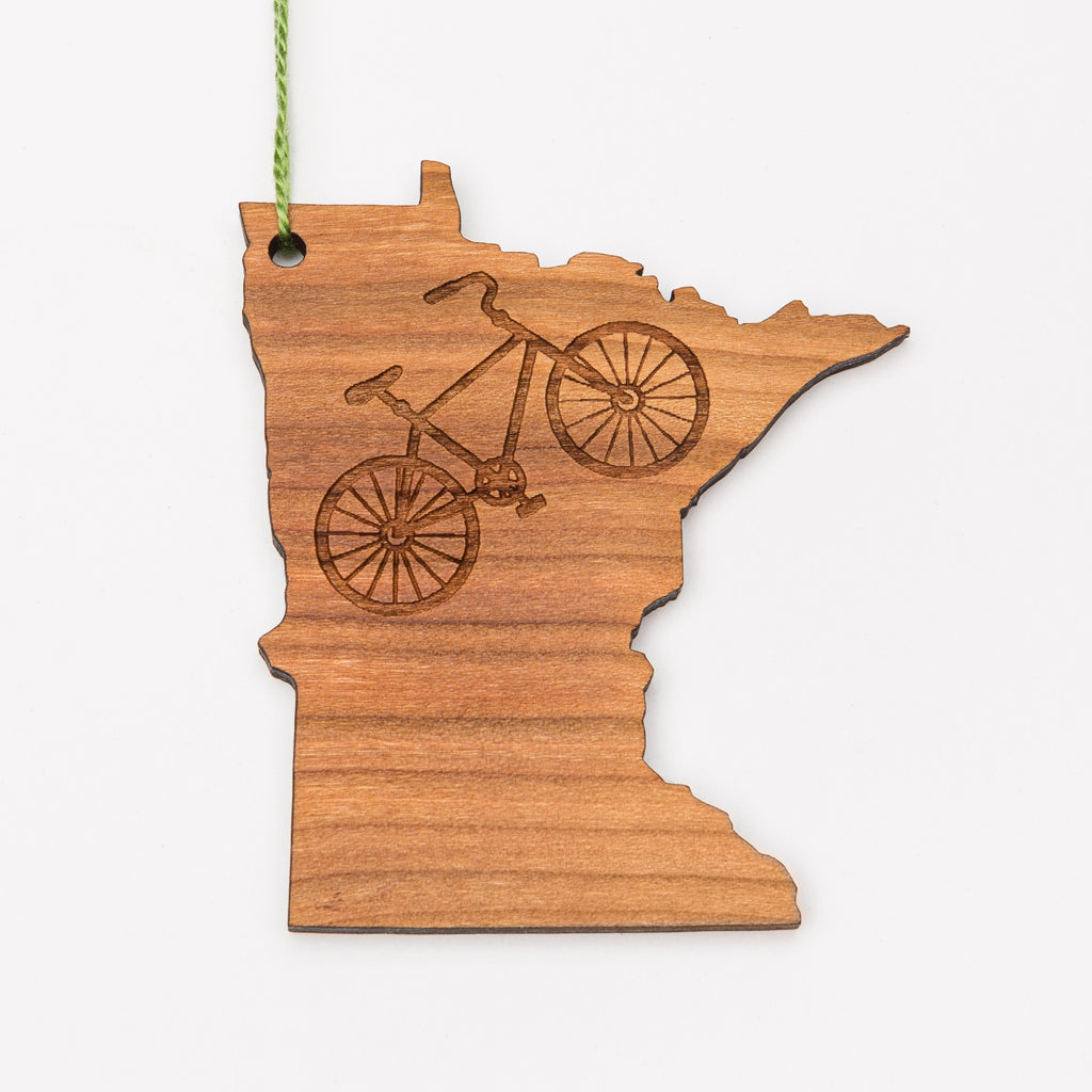 Laser engraved bicycle on a magnet or ornament shaped like Minnesota