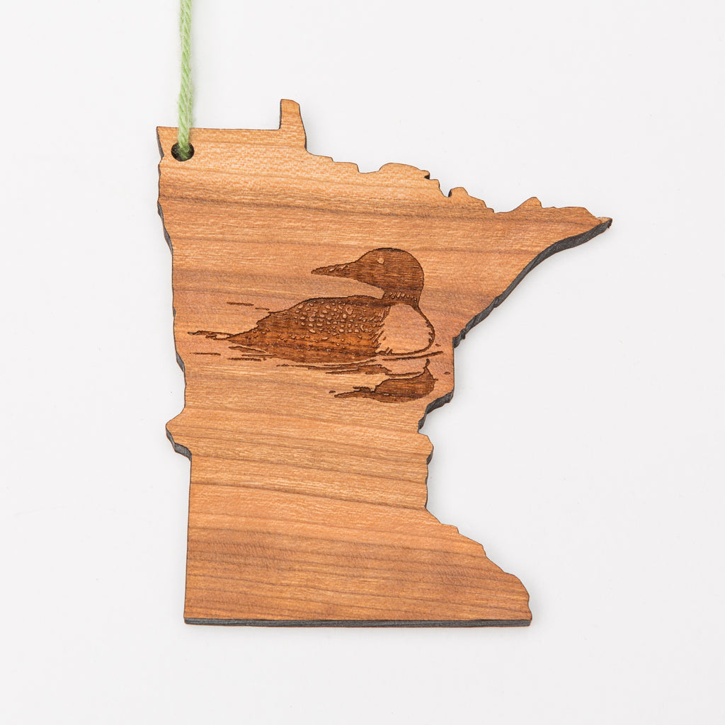 Laser etched loon on a wood ornament shaped like Minnesota