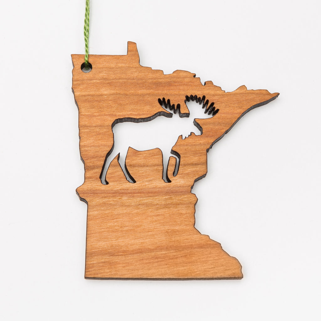 Laser cut moose in the middle of a wood Minnesota-shaped ornament