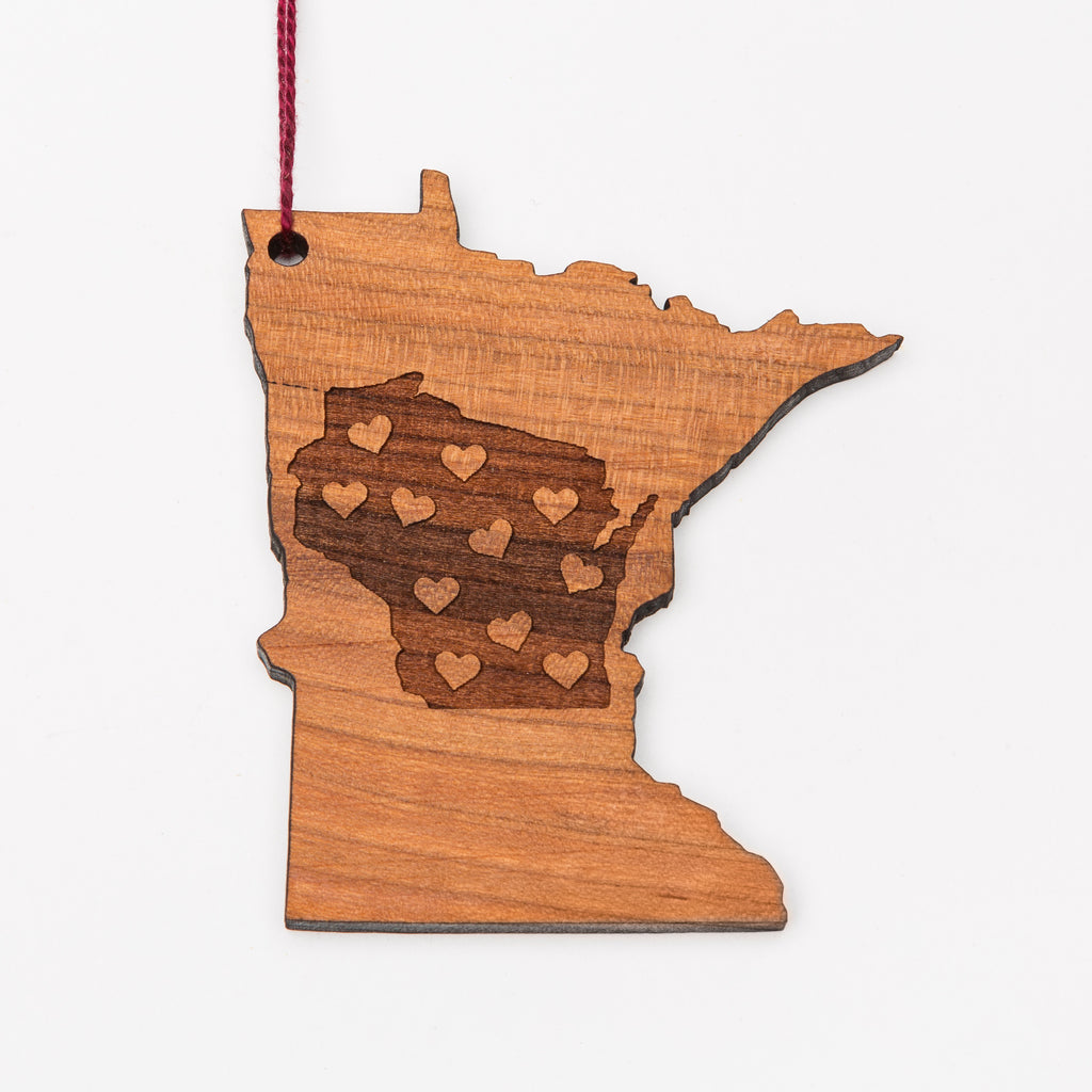 Wisconsin laser etched into a Minnesota-shaped wood ornament