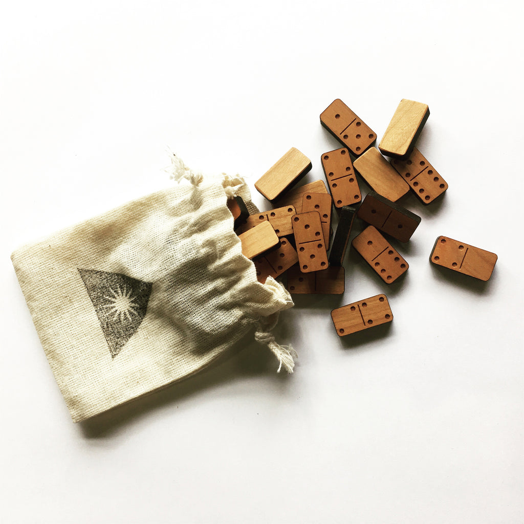 Mini wood block dominoes in a cloth pouch