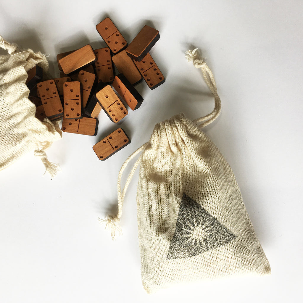 Mini wood block dominoes in cloth bags
