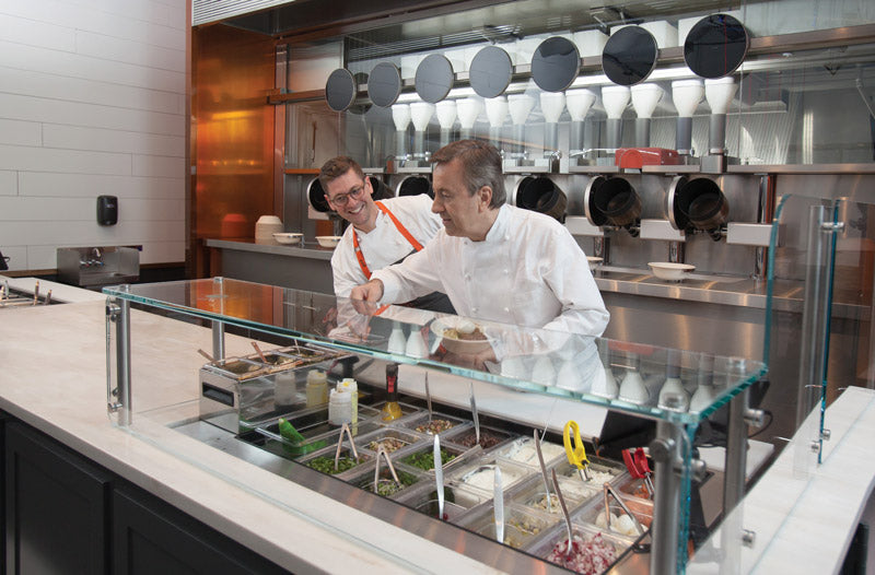 Culinary Director Daniel Boulud, right, and Executive Chef Sam Benson drive the creative recipes behind Spyce.