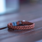Brown Cat collar made from Paracord with break away buckle lying on a wooden table (5181971759244)