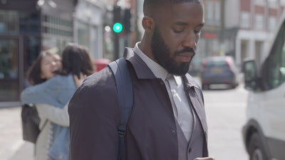 reachXOD - CIO - Small Business - Business man checking phone
