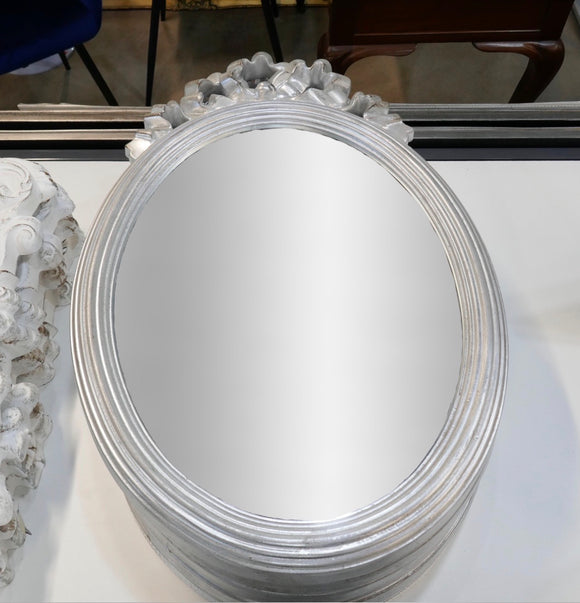 Silver decoration to top mirror