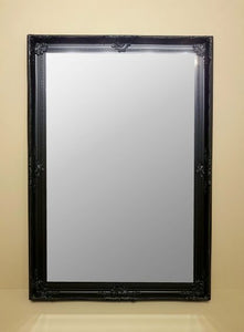 Black Mirror with ornate frame