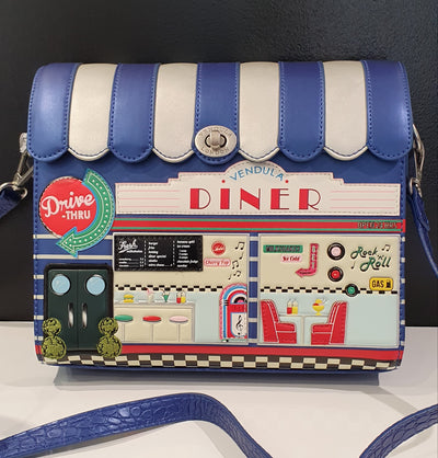 Vendula Diner Box Bag, very cool retro metallic blue and silver 50's diner, with booth seats and jukebox! The box bag is structured and has a long strap easy for across the body or shoulder wearing.  Vendula are vegan approved, and have a limited edition on their bags, making them a sort after range all over the world.