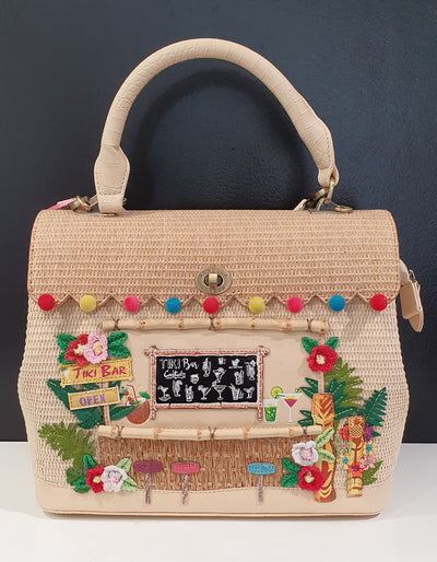 The Grace  tiki bar handbag is one of Vendula London's fabulous handcrafted beautiful animal freindly and loving pieces.. Designed by a team in London this range of handbags are very sort after across the world. A real treasure.  Also available in the Box Bag style smaller with shoulder strap.